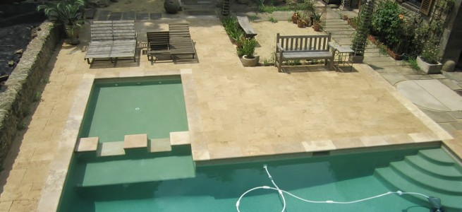 Beige Travertine pool deck and coping