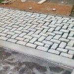 Installation of Belgium Block Drieveway Apron